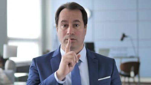 Finger on Lips, Businessman Gesturing Silence
