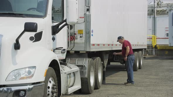 Thumbnail for Truck driver preparing trailer.  Fully released for commercial use.