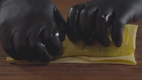 Hands of the Skill Chef in Black Rubber Gloves Making Shawarma
