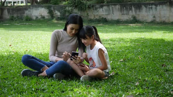 Young mother and little child daughter take a photo selfie from smartphone or cellphone