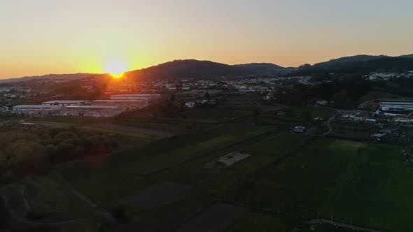 Thumbnail for Aerial View Flying Over River and Plain Fields at Sunset