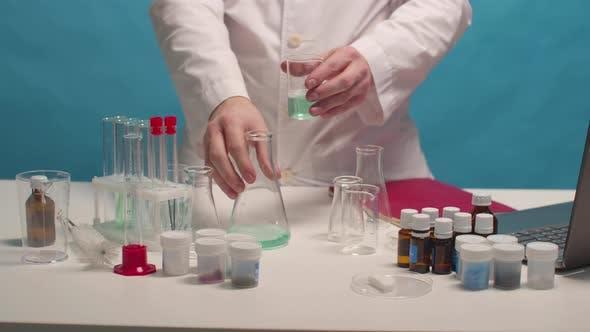 Scientist Mixes Alkali and Acid in Flasks