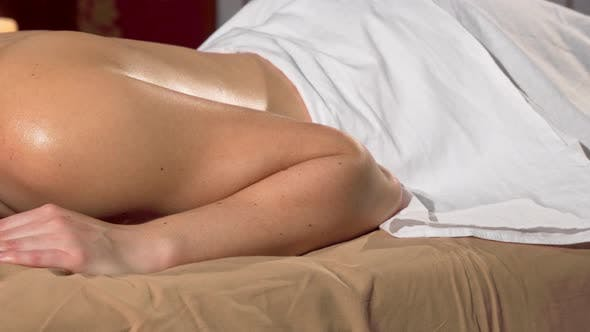 Thumbnail for Woman Resting on Massage Table at the Spa, Candles Burning on Background