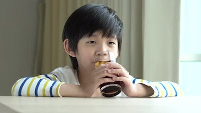 Little Asian Boy Drinking Soft Drink Cola Soda