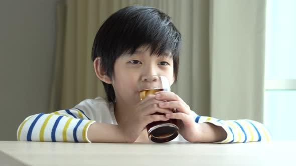 Little Asian Boy Drinking Soft Drink Cola Soda
