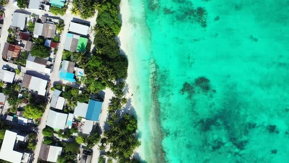 Thumbnail for Wide above clean view of a white sand paradise beach and aqua turquoise water background in high res
