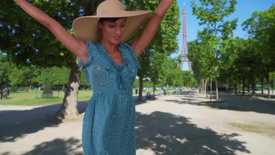 Thumbnail for Happy black woman dancing with excitement near Eiffel Tower in Paris