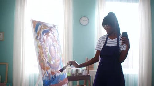 Black Woman Is Painting and Filming Vlog