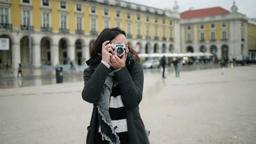 Cheerful Tourist Girl Wearing Overcoat and Scarf