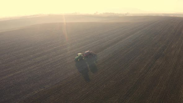 Thumbnail for Aerial View Of Harvest Fields. Tractor Driving Across The Field