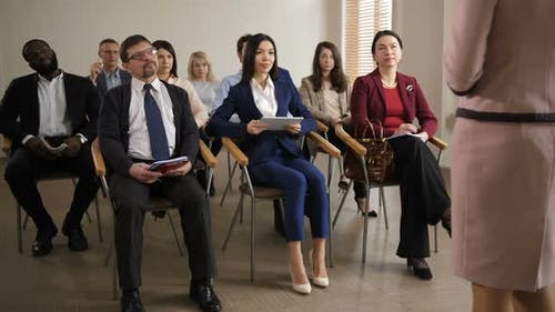 Group of Multiracial Listeners at Business Seminar