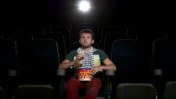 Thumbnail for Happy Young Man Watching Movie Alone in Empty Theater