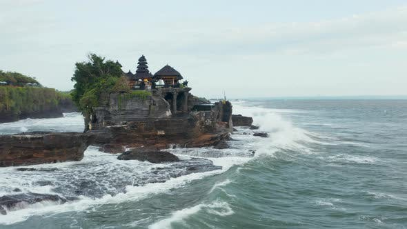 Tanah Lot Temple on Rocky Cliff in Bali Indonesia Pounded By Strong Waves From the Open Sea