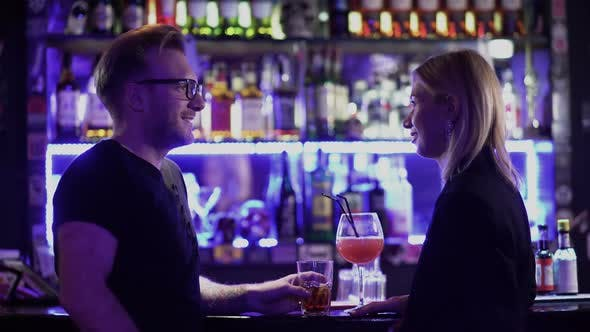 Thumbnail for Adult Couple Drink Cocktails at the Bar Counter