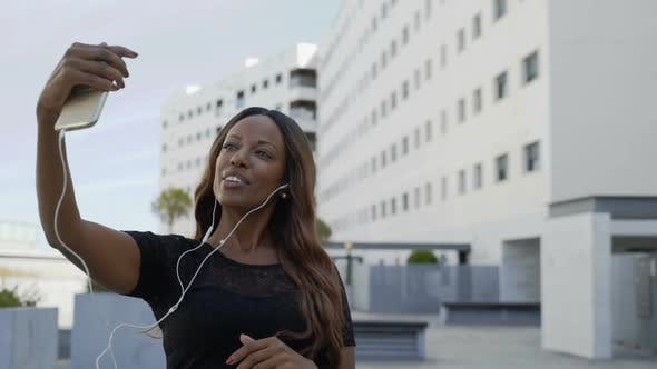 Thumbnail for Happy African American Woman Having Video Chat on Smartphone