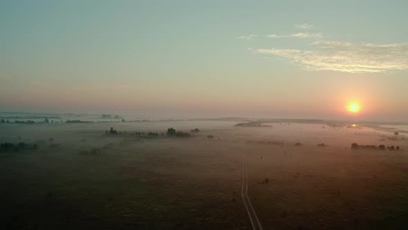 Aerial Drone View. Beautiful Misty Dawn in the Spring on the Lake. and Rural Road
