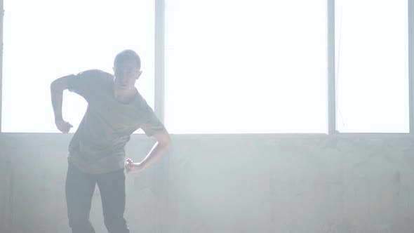 Thumbnail for Confident Young Passionate Hip-hop Dancer Performing in the Fog