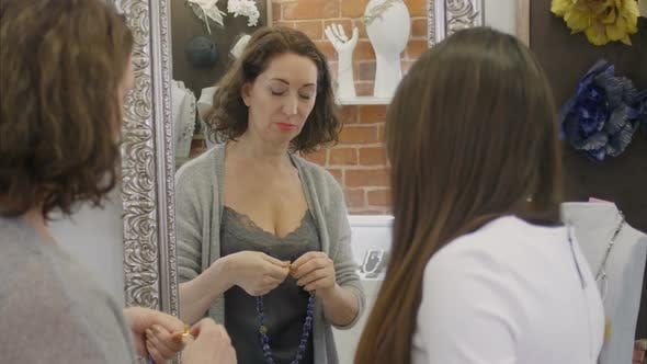 Thumbnail for Women Examining Necklaces in Store