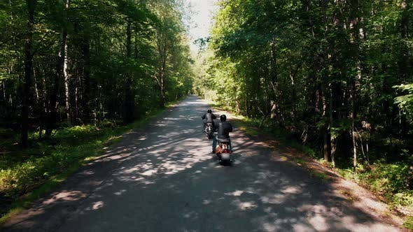 Thumbnail for Two Brutal Men Motorcyclists Riding Their Motorbikes in the Forest - Bright Sunny Day