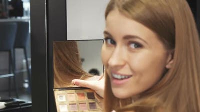 Cropped Shot of a Beautiful Woman Smiling Looking at the Mirror