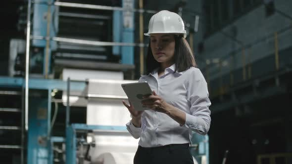 Thumbnail for Female Engineer with Tablet