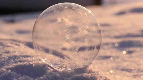 Soap Bubble in the Snow in Winter