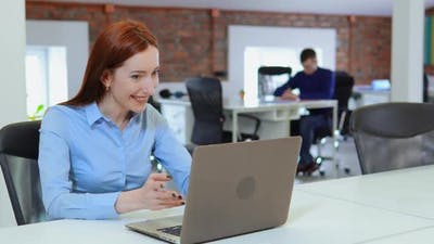 Female Worker Talking Via Skype