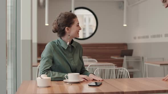 Man and Woman Meeting in Cafe