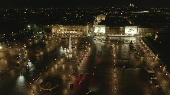 Cover Image for AERIAL: Flight Over Place De La Concorde in Paris, France at Night with Wet Reflecting Ground and