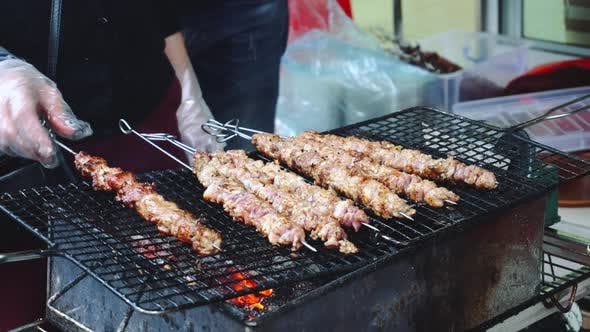 Thumbnail for Grilling Meat, Street Food. Crocodile Meat Skewer Bbq Roasted In Asian Street Market Exotic Food.