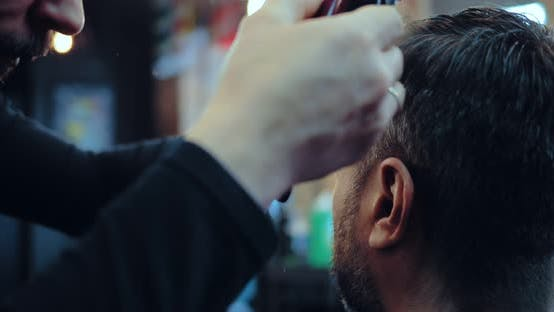 Hair Stylist Works with a Hair Clipper and Comb. Close-up