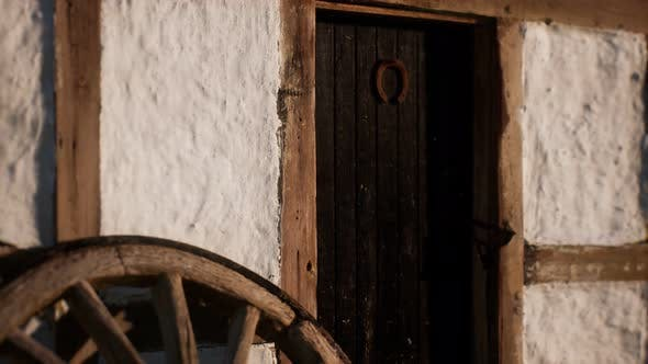Thumbnail for Old Wood Wheel and Black Door at White House