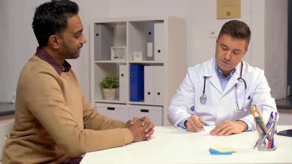 Male Doctor Giving Prescription To Patient 11