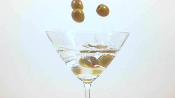 Thumbnail for Olives falling into Martini glass