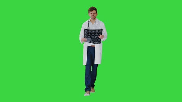 Thumbnail for Concentrated Male Doctor Examining Computed Tomography While Walking on a Green Screen, Chroma Key.