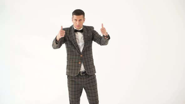 Thumbnail for Man in a Plaid Suit is Depicting a Cheerful and Serious Facial Expression