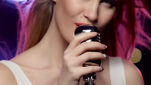 Thumbnail for Woman Singing Close-up: Mouth and Hands Touch the Vintage Microphone