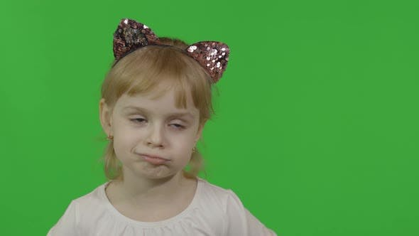 Thumbnail for Girl in Headband with a Cat Ears Shows Emotion of Dissatisfied