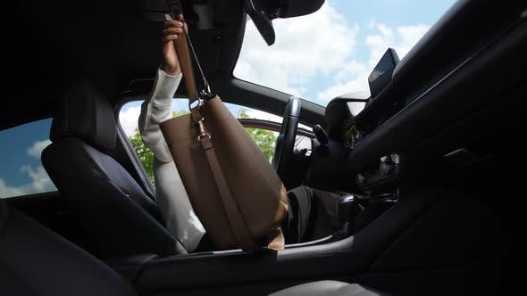 Thumbnail for Woman Getting Into Car and Wearing Seat Belt