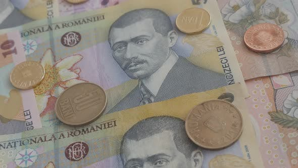 Thumbnail for Romanian national currency details 3840X2160p 30fps UltraHD    video - Coins and paper banknotes of