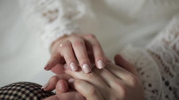 Newlyweds Hands. Bride and Groom Touch Each Other. Happy Wedding Couple Family in Love