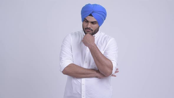 Cover Image for Serious Young Bearded Indian Sikh Man Thinking