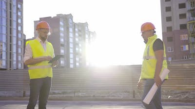 Builders Meet in the Early Morning Sunrise