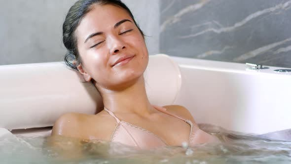 Cover Image for Young Woman Relaxing in Jacuzzi