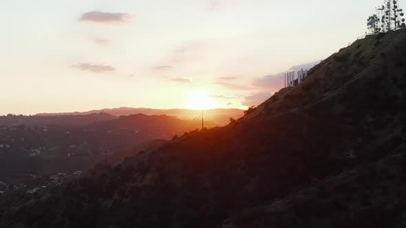 Thumbnail for AERIAL: Hollywood Hills in Beautiful Sunset Golden Hour Light and View on Hollywood Sign on Mountain