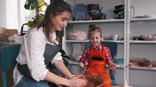 Ceramic Artist Teaching Kid How To Create Ceramics