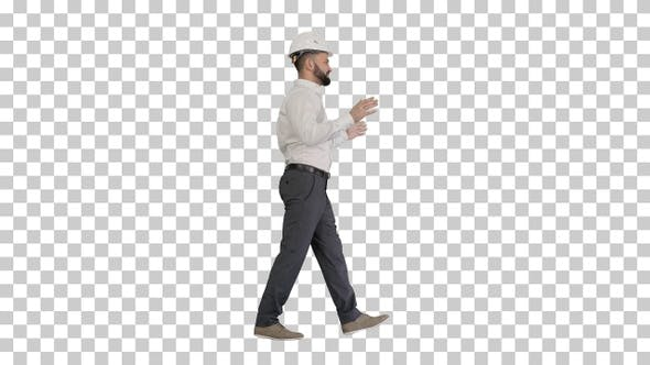 Engineer in hardhat walking and explaining something, Alpha Channel