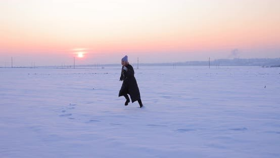 Thumbnail for Woman Running on the Snow in the Snowy Arctic