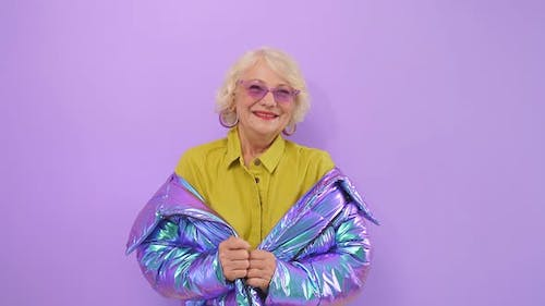 Cute, Positive Old Lady Smiling Posing in the Studio on an Isolated Background