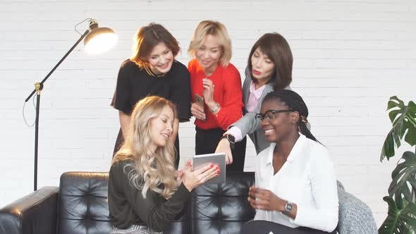 Thumbnail for Group of Female Fashion Professionals Working on Design Clothes Sitting at Table